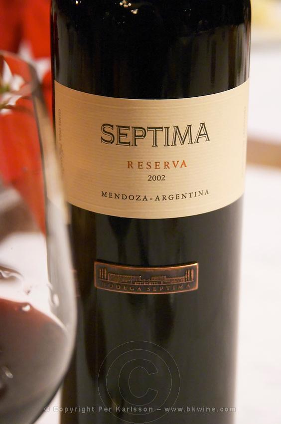 Bottle of Septima Mendoza 2002 Reserva from Codorniu Mendoza and a glass of wine. The Oviedo Restaurant, Buenos Aires Argentina, South America