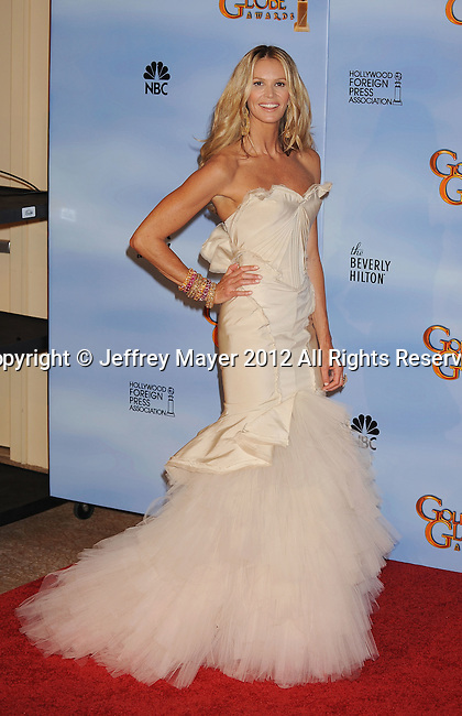 BEVERLY HILLS, CA - JANUARY 15: Elle Macpherson  poses in the press room at the 69th Annual Golden Globe Awards held at the Beverly Hilton Hotel on January 15, 2012 in Beverly Hills, California.
