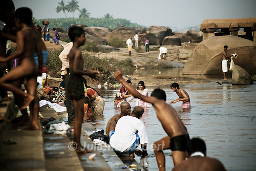 Kids play in the river in Hampi, Karnataka, India