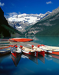 Banff National Park, Alberta, Canada    <br /> Red canoes tied at the boat dock on Lake Louise with Mount Victoria and Victoria Glacier in the distance