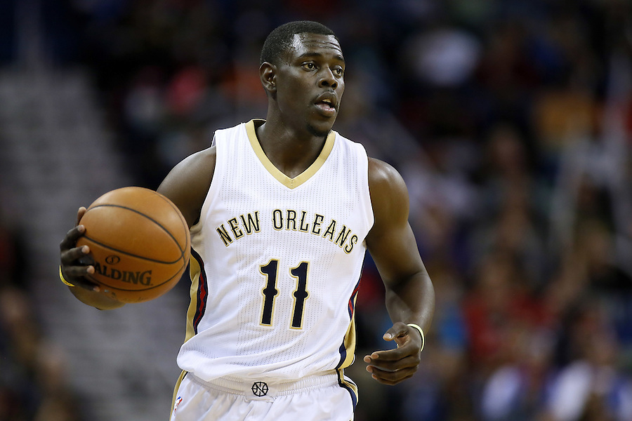 New Orleans Pelicans guard Jrue Holiday (11) drives with the ball during the first half of an NBA basketball game against the Oklahoma City Thunder Thursday, Feb. 25, 2016, in New Orleans. (AP Photo/Jonathan Bachman)