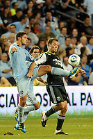 Milos Stojcev (88)  midfielder Sporting KC takes the ball off of Jack Jewsbury (13) midfielder Portland Timber..... Sporting Kansas City defeated Portland Timbers 3-1 at LIVESTRONG Sporting Park, Kansas City, Kansas.