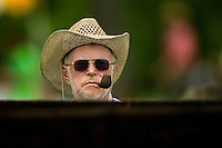A man watches the races during the Queen's Cup Steeplechase in Mineral Springs, NC.