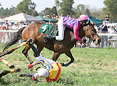 Jamey Price holds onto Bold Turn as Brian Crowley does a tuck and roll in the Ford Conger at Aiken Spring.