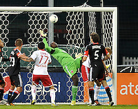 D.C. United goalkeeper Bill Hamid (28) goes up and tries to make a save.  The New York Red Bulls tied D.C. United 1-1 in the first leg of the Eastern Conference semifinals at RFK Stadium, Saturday November 3, 2012.