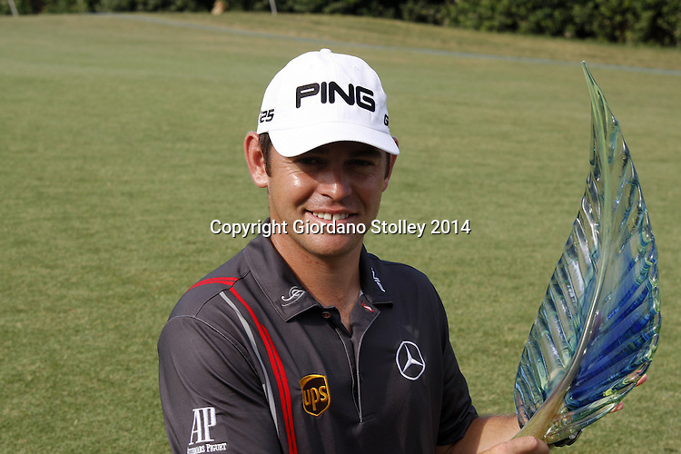 DURBAN - 12 January 2014 - South African golfer Louis Oosthuizen holds his trophy after winning the Volvo Golf Champions that was held at the Durban Country Club. Picture: Allied Picture Press/APP