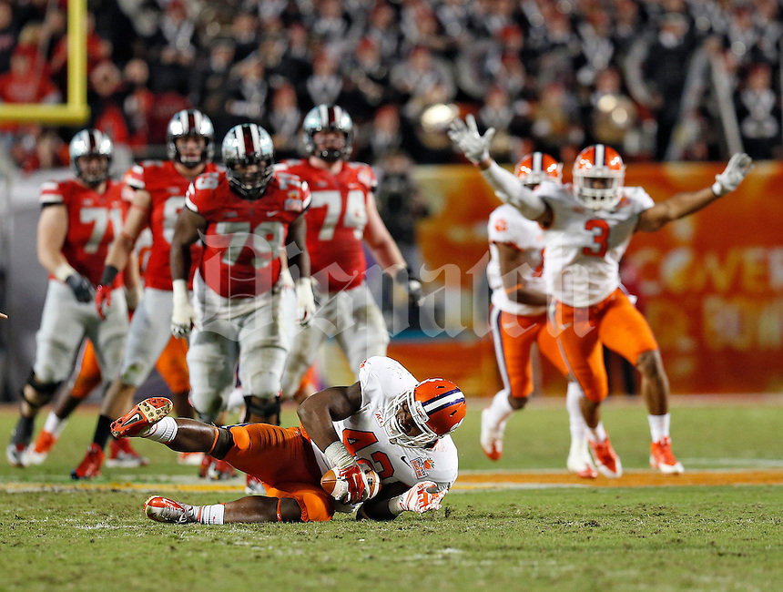 Clemson Tigers linebacker Stephone Anthony (42) comes up with an interception on a Ohio State Buckeyes quarterback Braxton Miller (5) pass in the 4th quarter of their game in the Discover Orange Bowl at Sun Life Stadium in Miami Gardens, Florida on January 3, 2014.(Dispatch photo by Kyle Robertson)