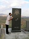 Armenia 2007 <br /> In a Yezidi graveyard  , a man kissing a modern funerary stele                                                   <br /> Armenie 2007  <br /> Dans un cimetiere Yezidi d'un village, un homme embrassant une stele funeraire moderne.