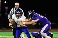 Ozark vs Elkins - Hayden Hurst (55) of Elkins tries to bring down Tyler Sanders (11) of Ozark at John Bunch Field, Elkins, AR  on Friday, November 2 2018.   Special to NWA Democrat-Gazette/ David Beach