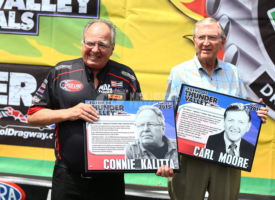 Jun 21, 2015; Bristol, TN, USA; NHRA Connie Kalitta (left) and Carl Moore are inducted into the Legends of Thunder Valley hall of fame during the Thunder Valley Nationals at Bristol Dragway. Mandatory Credit: Mark J. Rebilas-