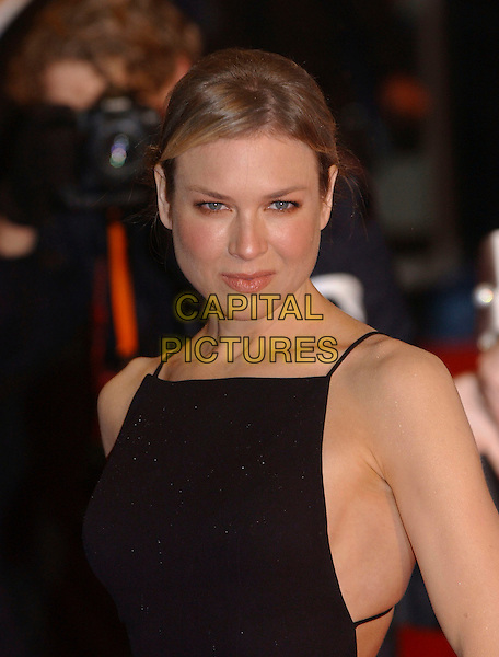 RENEE ZELLWEGER.Arrivals at The Orange British Academy Film Awards, .(BAFTA's) Odeon Leicester Square, London, England,.19 February 2006.bafta baftas half length black dress.Ref: FIN.www.capitalpictures.com.sales@capitalpictures.com.©Steve Finn/Capital Pictures.