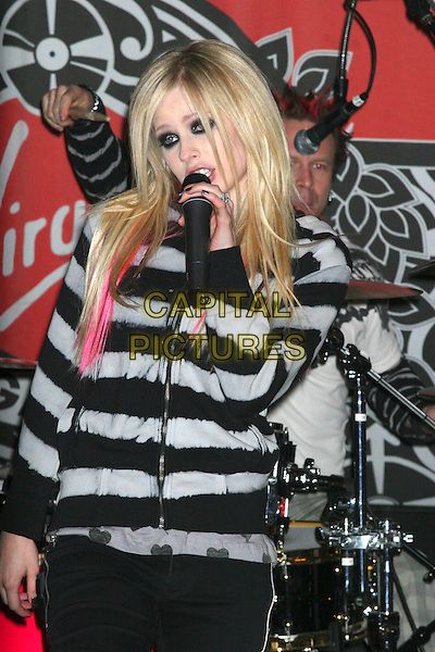 AVRIL LAVIGNE.At her In-Store Performance at Virgin Megastore, New York, NY, USA..April 18th, 2007.half length black grey gray top pink hair streaks eyeliner makeup make up make-up live in concert gig performance singing microphone nail varnish polish.CAP/IW.©Ian Wilson/Capital Pictures