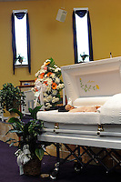 The body of housing activist Beauty Turner, 51, a one-time resident of the Robert Taylor Homes who led the Beauty Turner Ghetto Bus Tour and received national recognition in publications such as The Wall Street Journal, lies in an open casket during her wake at the Greater Harvest Missionary Baptist Church on South State Street in Chicago, Illinois on December 26, 2008.  Turner died of an aneurysm on December 18.