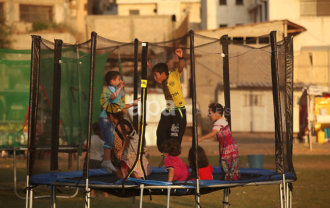 Palestinian children play at the Gaza seaport, on July 06, 2015. Photo by Ashraf Amra