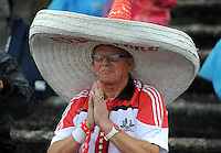 18-07-2015: Praying for the rain to stop is Cork fan Tom De Bomber in the Munster senior football championship final replay at Fitzgerald Stadium, Killarney, on Saturday night. <br /> Photo: Don MacMonagle - macmonagle.com