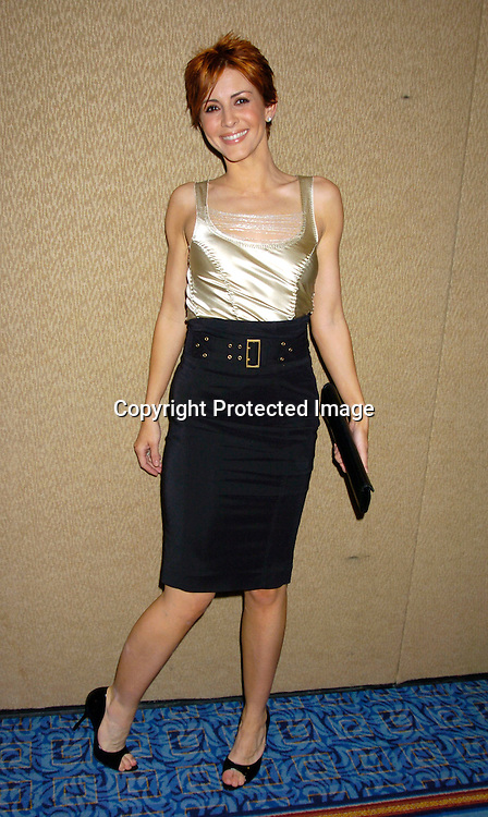 Michelle Clunie ..at the Cable Positive benefit of March 30, 2004 at the ..Marriott Marquis Hotel...Photo by Robin Platzer, Twin Images....
