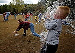 Michael Cupit, 6, of East Hartford, gets all wet as a balloon full of water explodes on impact tossed by his dad Tom, during a Water Balloon Toss,  Saturday during the 24th annual Northwest Park Country Fair sponsored by Friends of Northwest Park, games, food and crafts and events like the egg drop contest  and tog-O-War were among the activities A Jim Michaud piv 09306