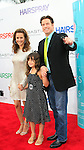 John Travolta with Kelly Preston and their daughter at the premiere of 'Hairspray' at the Mann Village Theater in Westwood, Los Angeles, California on July 10, 2007. Photopro.