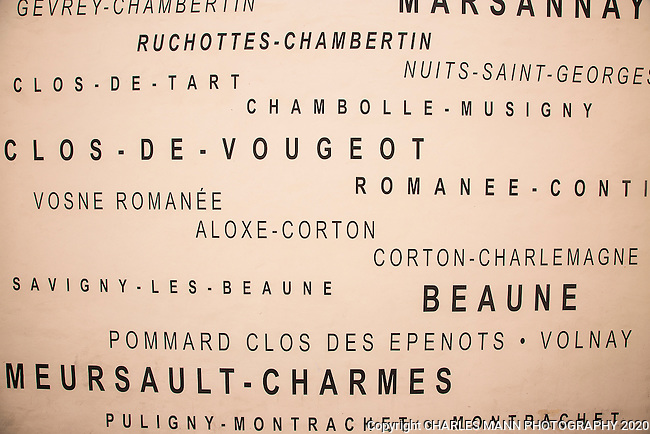 A poster in Beaune hints at the many famous vinyards in the region.