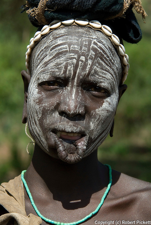 Woman with face painted and cut lip, Mursi Tribe, Mago National Park, Lower Omo Valley, Ethiopia, portrait, person, one, tribes, tribal, indigenous, peoples, Southern, ethnic, rural, local, traditional, culture, primitive,Africa