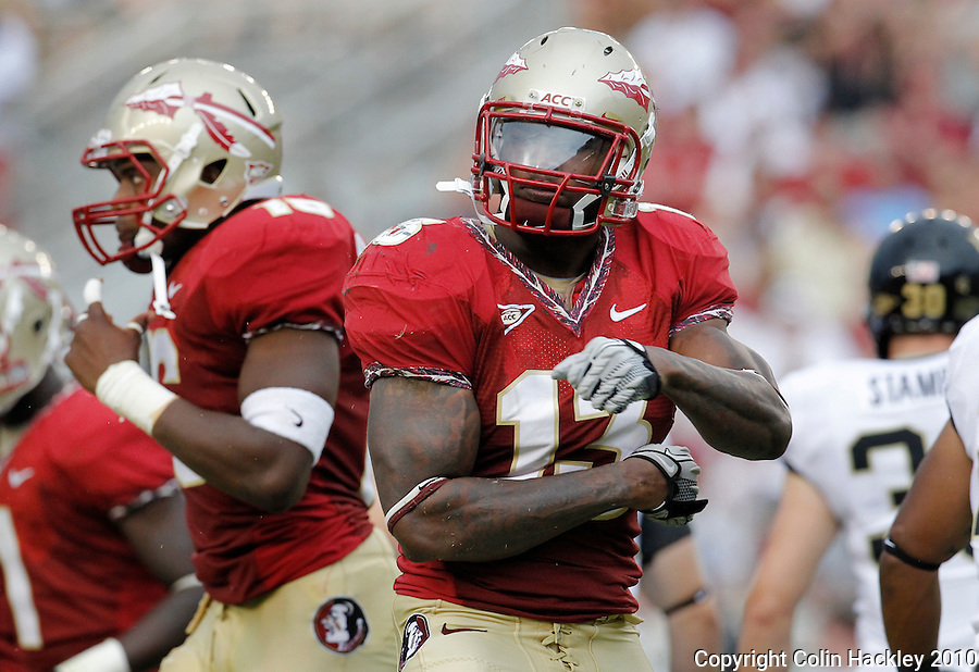TALLAHASSEE, FL 9/25/10-FSU-WF FB10 CH-Florida State's Nigel Bradham celebrates a tackle against Wake Forest during second half action Saturday at Doak Campbell Stadium in Tallahassee. The Seminoles beat the Demon Deacons 31-0..COLIN HACKLEY PHOTO