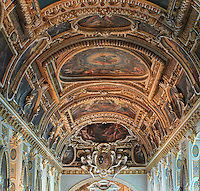 Ceiling of La Chapelle de la Trinite or Chapel of the Trinity, 16th century, originally a monastery church belonging to the Mathurin monks under Saint Louis and re-annexed to the chateau under Francois I, Chateau de Fontainebleau, France. The proto-baroque decor is of the Second Ecole de Fontainebleau style. Louis XV was married in this chapel in the 18th century and Napoleon III was baptised here in the early 19th century. The Palace of Fontainebleau is one of the largest French royal palaces and was begun in the early 16th century for Francois I. It was listed as a UNESCO World Heritage Site in 1981. Picture by Manuel Cohen