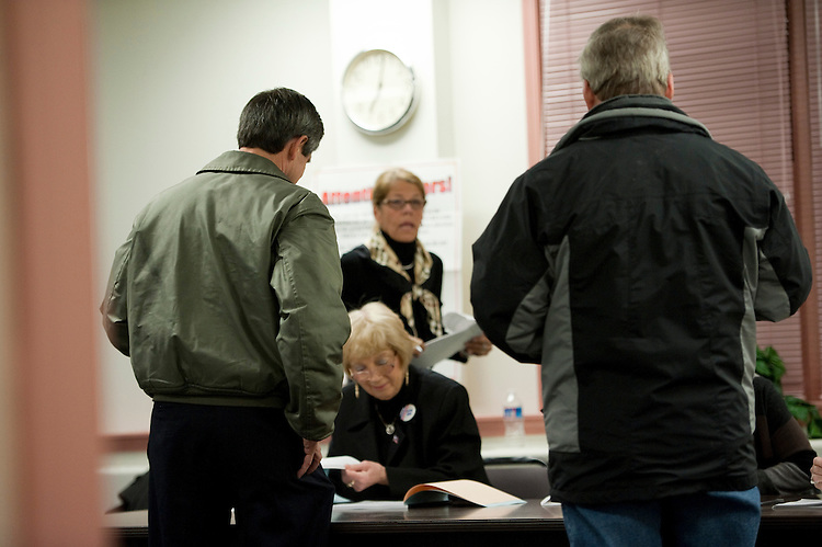 EDGMONT TOWNSHIP, PA - Nov 02: U.S. Rep. Joe Sestak, D-Pa., left, candidate for U.S. Senate, checks in to vote at the Edgmont Township Fire Company. He was fourth in line. His opponent is Republican Pat Toomey.  (Photo by Scott J. Ferrell/Congressional Quarterly)