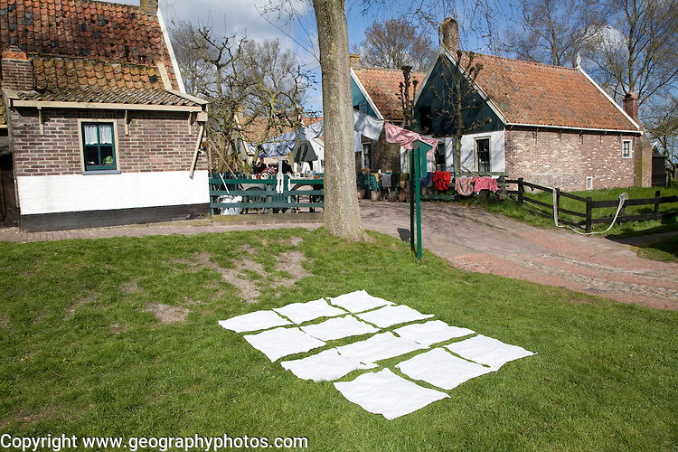 Washing out to dry on grass Urk village, Zuiderzee museum, Enkhuizen, Netherlands