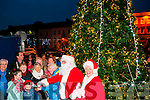 Listowel Lights Switch On: Members of the Listowel Tidy town's committee with Santa & Mrs Claus switching on  the  Christmas lights switch  in Listowel on Sunday evening last.