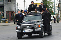 President Mahmoud Ahmadinejad is seen in his armoured Nissan jeep with gun-carrying bodyguards hanging on to all sides of the car, as he is driven to deliver a speech in the central Iranian town of Isfahan (Esfahan). On each trip he makes, Mr Ahmadinejad is accompanied by up to 100 bodyguards as he claims that Western intelligence organizations are planning to assassinate him....