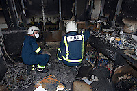 Fire investigation officers searching for clues as to the cause of a severe school fire Oxfordshire UK. This image may only be used to portray the subject in a positive manner..©shoutpictures.com.. john@shoutpictures.com