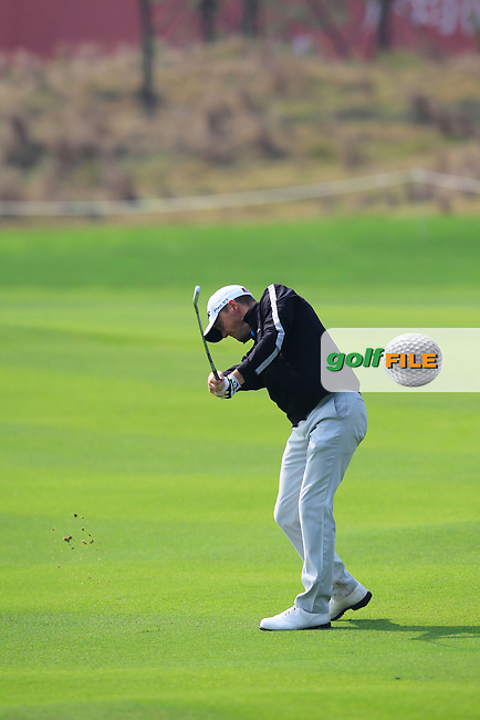 Michael Hoey (NIR) plays his 2nd shot on the 9th hole during Sunday's Final Round of the 2014 BMW Masters held at Lake Malaren, Shanghai, China. 2nd November 2014.<br /> Picture: Eoin Clarke www.golffile.ie