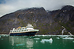 The National Geographic Sea Bird anchored in Endicott Arm near Dawes Glacier in Alaska's Inside Passage, Tracy Arm-Fords Terror Wilderness Area in the Tongass National Forest.