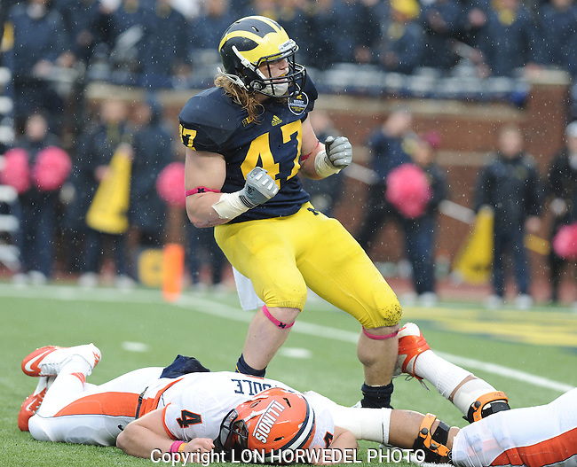 Saturday, October 13: Michigan's Jake Ryan celebrates after crushing Illinois quarterback Reilly O'Toole and causing him to fumble during third quarter action of UM's 45-0 route over Illinois, Saturday at Michigan Stadium.Michigan linebacker Jake Ryan in action 2012.