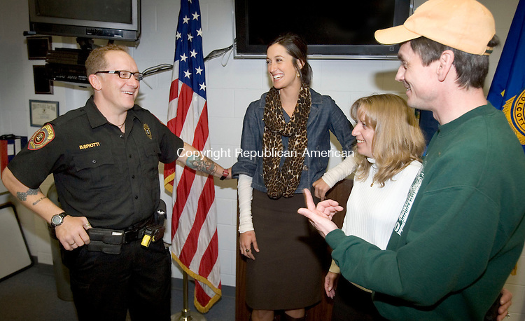 WOLCOTT, CT. 04 November 2011-110711SV08--<br /> From left, Bryan Spiotti, Wolcott police officer, talks with Mikara Cimmin of St. Jude Children Research Hospital and Robert and Amy Stephens of Wolcott at the police station in Wolcott Monday. Spiotti was acknowledged for consoling a child whose mom was dying of cancer. Spiotti responded to the call to provide medical assistance and accompanied the family to the hospital. The boy's father is so pleased with Spiotti that he offered to donate $1,000 to a charity of Spiotti's choice. He chose St. Jude's Children's Hospital. <br /> Steven Valenti Republican-American