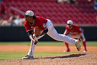 Carolina Mudcats relief pitcher Freddy Peralta (45) follows through on his delivery against the Winston-Salem Dash at Five County Stadium on May 14, 2017 in Zebulon, North Carolina.  The Mudcats walked-off the Dash 11-10.  (Brian Westerholt/Four Seam Images)