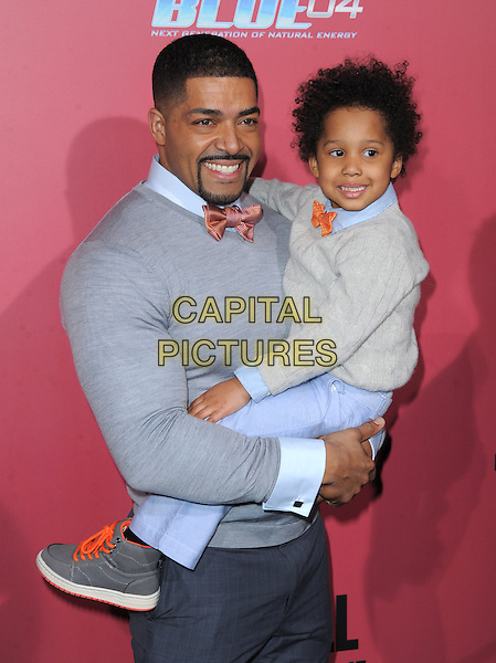 David Otunga and David Daniel Otunga, Jr..'The Call' world film premiere, Arclight Cinemas, Hollywood, California, USA. 5th March 2013.half length grey gray tops sweater goatee facial hair jumper jeans denim kid child holding carrying father dad son family.CAP/DVS.©DVS/Capital Pictures