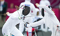 12 AUG 2012 - LONDON, GBR - Chloe Esposito (AUS) (left) of Australia and Elena Rublevska of Latvia evade each others attacks during their women's London 2012 Olympic Games Modern Pentathlon fencing match at The Copper Box in the Olympic Park, in Stratford, London, Great Britain (PHOTO (C) 2012 NIGEL FARROW)