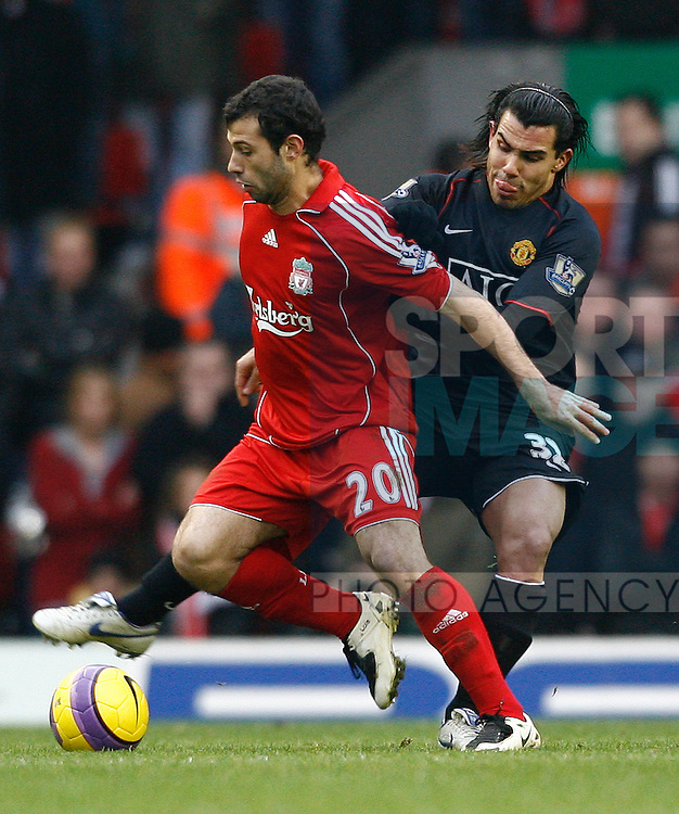 Liverpool's Javier Mascherano tackled by Manchester United's Carlos Tevez