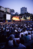 Montreal (Qc) CANADA, July 1997-<br /> outdoor scene at the<br /> Montreal Jazz Festival, sponsored by Tobacco  brand Dumaurier.<br /> In background ; Montreal landmark Place Ville- Marie<br /> -Photo (c)  Images Distribution