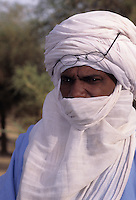 Akadaney, Niger. A Fulani Man wearing a Tuareg Tagelmust, or Veil.  This is an example of how one culture, the Fulani, in close contact with another, may adopt the other's clothing styles.