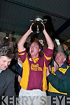 Duaghs Aiden Kelly lifts the Munster Junior Club Football Championship trophy aloft after their win over Adrigole.