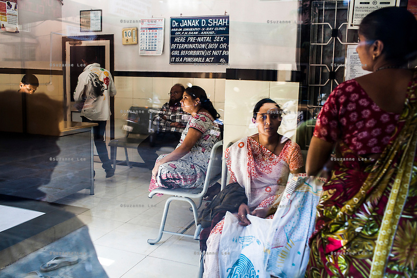 9 months pregnant, Leela Mekwan (center), 34, waits for a doctor's checkup in preparation for her Caesarian section delivery today in the Akanksha Clinic in Anand, Gujarat, India on 12th December 2012. Photo by Suzanne Lee / Marie-Claire France