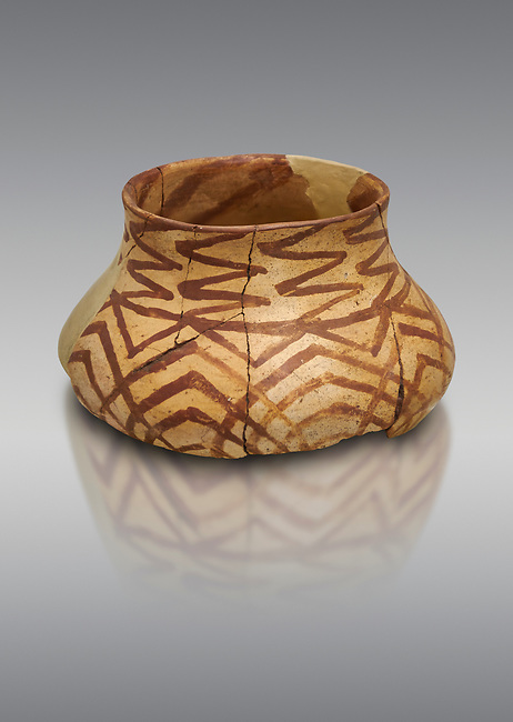 Chalcolithic decorated terra cotta pot. Circa 5000BC. Catalhoyuk collection, Konya Archaeological Museum, Turkey. Against a gray background