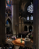 The flag-draped casket of former President George H.W. Bush is carried by a military honor guard during his State Funeral Service at Washington National Cathedral in Washington, Wednesday, Dec. 5, 2018. (AP Photo/Carolyn Kaster)