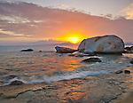 Virgin Gorda, British Virgin Islands, Caribbean <br /> Setting sun illuminates the beach at The Baths National Park .