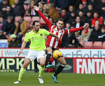 John Joe O'Toole of Northampton and Billy Sharp of Sheffield Utd during the English League One match at Bramall Lane Stadium, Sheffield. Picture date: December 31st, 2016. Pic Simon Bellis/Sportimage