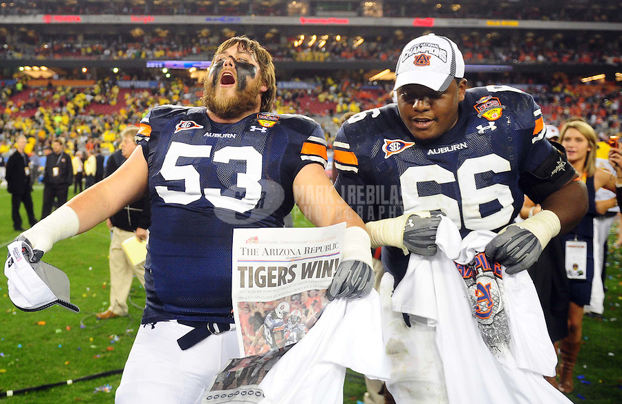Jan 10, 2011; Glendale, AZ, USA;Auburn Tigers offensive linesman Bart Eddins (53) and offensive linesman Mike Berry (66) celebrate after defeating the Oregon Ducks 22-19 in the 2011 BCS National Championship game at University of Phoenix Stadium.  Mandatory Credit: Mark J. Rebilas-