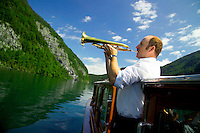 Berchtesgaden National Park, Bavavia, Germany, July 2004.  The boat man plays his trumpet on the Konigsee, to demonstrate the echo's by the high mountains surrounding the lake. We are trekking  from hut to hut in the Bavarian mountains of Berchtesgaden. Photo by Frits Meyst/Adventure4ever.com