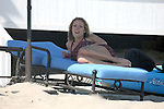 8-7-09..Filming an episode of the Hills in Malibu California..Kristin Cavallari wearing a black bikini under her dress. Kristin was drinking some beer and even played a little racket ball with the crew members in between filming. ...AbilityFilms@yahoo.com.805-427-3519.www.AbilityFilms.com
